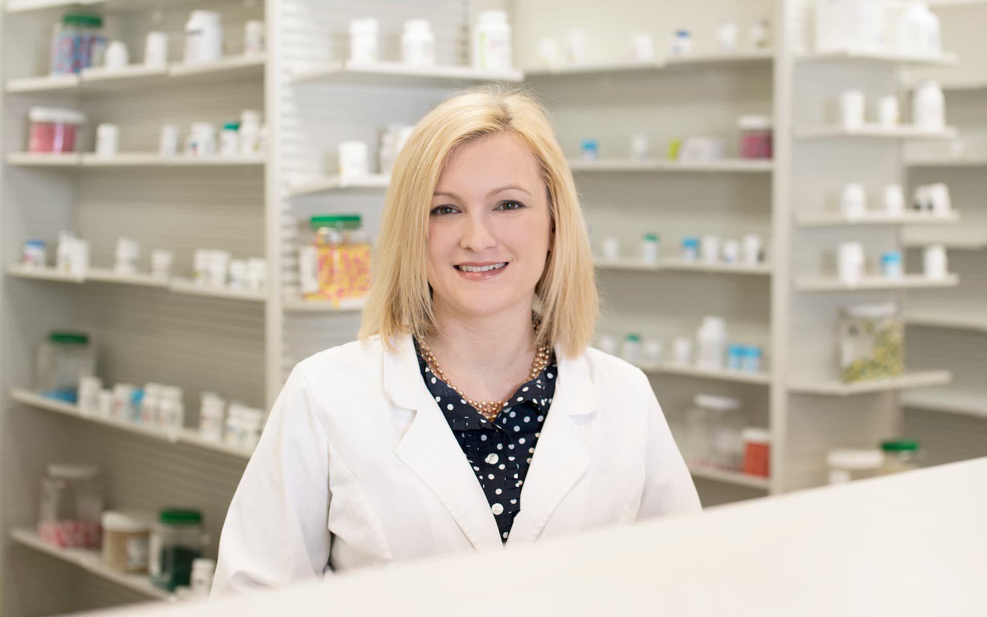 A headshot of Leah B. Argie inside the pharmacy